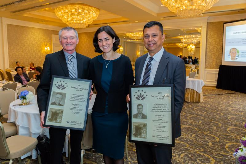 PHC President and CEO Fiona Dalton congratulates the winners of this year's Research & Mission Award, Dr. Jim Christenson (left) and Dr. Aslam Anis (right)