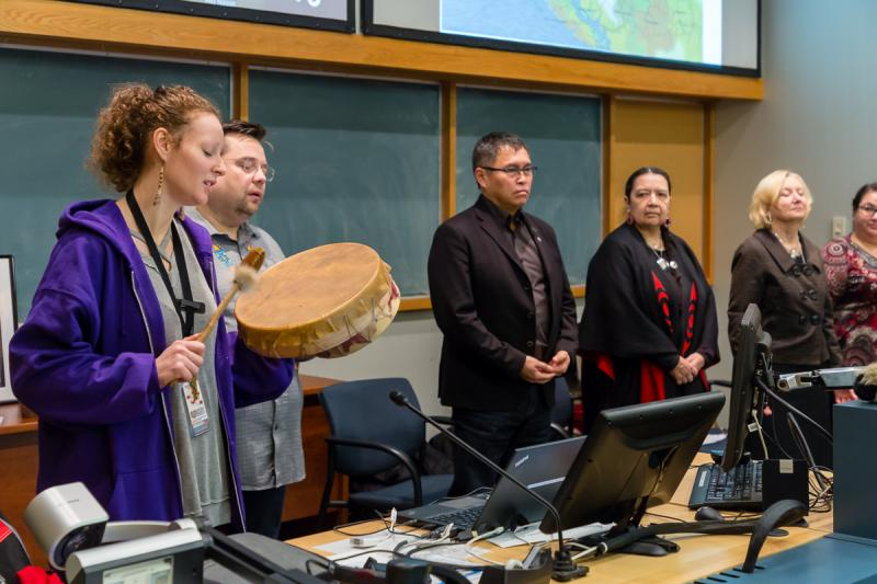 Rebecca Hatch and Neil Fowler of PHC's Aboriginal Health Team sing a traditional wolf song as FNHA CEO Joe Gallagher, Squamish Nation elder Syexwaliya, PHC CEO Dianne Doyle and FNHA's Sonia Isaac-Mann listen.