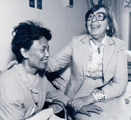 Dr. Josephine Mallek, St. Paul's first female physician, caring for one of her patients during her years at St. Paul's.