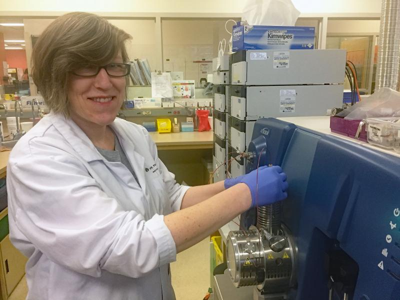 Grace van der Gugten, an assay development specialist in the clinical laboratory at St. Paul's Hospital, analyzing participant samples for Alzheimer's disease biomarker testing as part of the IMPACT-AD study.