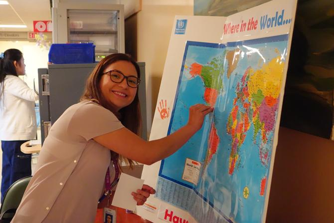 """Vicky from 10B, adding her pin to IPAC's """"Where in the World Have You Cleaned Your Hands?"""" map."""