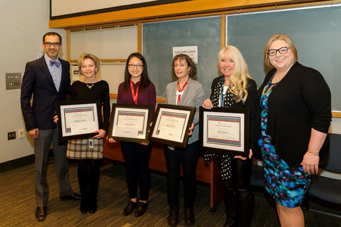 Dr. Sean Virani (left) and Amanda Harvey (right) pose with this year's winners.