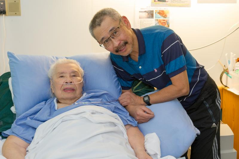 Ray Chan with his mother, Yuk Sim, a resident at Mount Saint Joseph Hospital