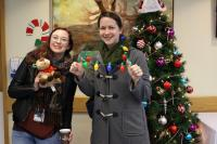 (L - R) Jenica Montgomery and Christine Lyon, Communications Specialists at Providence Health Care, enjoy the Christmas festivities, including the holiday meals!