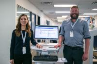 Clinical informatics specialist Emma Iacoe during her CST orientation with Eric Starr (CST Cardiac Program Liaison), learning what she'll need to know to support PHC for CST.