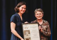 PHC CEO Fiona Dalton presents the 2019 Research and Mission Award to Dr. Karin Humphries last spring.