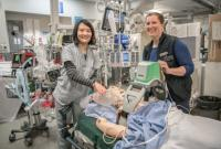 A Clinical Nurse Leader provides orientation to a nurse in the Emergency Department at St. Paul's Hospital.