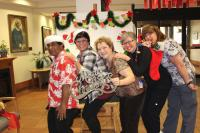 Stop by HR's Christmas photo booth at the staff appreciation Christmas meals for a family photo!