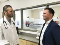 Dr. Liam Brunham chats with patient Richard Myers in the lab at the Centre for Heart Lung Innovation at SPH.
