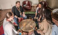 PHC's Indigenous Health Team gather in a drumming circle inside the All Nations Sacred Space at St. Paul's Hospital, specifically mentioned by the editors of Canada's Best Diversity Employers.